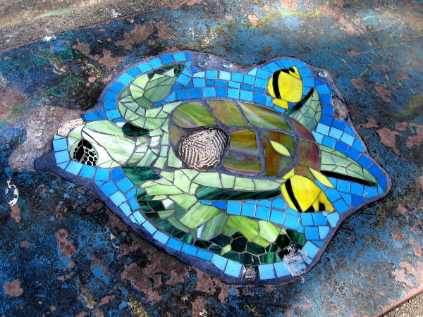 Several years ago--I forget how long--the picnic benches along the water were all decorated with colorful tile artwork. This is all that now remains.