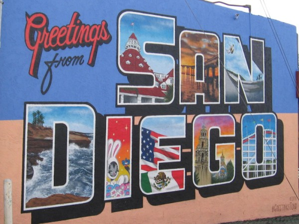 Greetings from SAN DIEGO. Cool urban art on 30th Street, just south of El Cajon Boulevard in North Park. Locations in the letters include the Ocean Beach Pier, La Jolla Cove and the Giant Dipper Roller Coaster at Belmont Park in Mission Beach.