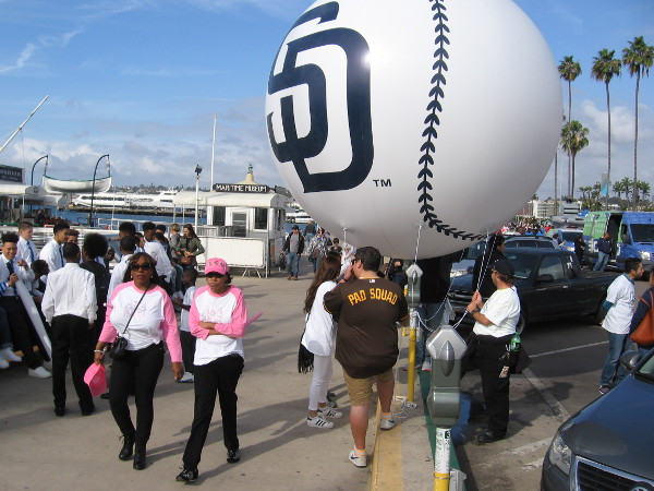 The San Diego Padres would be in the parade. They were waiting with some baseball balloons by the Maritime Museum.