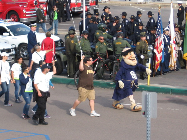 The parade has begun and here comes the Padres' happy mascot, the Swinging Friar!