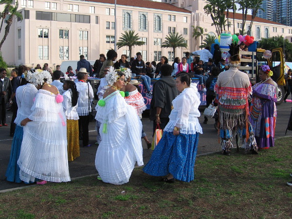 Lots of colorful costumes and finery representing different backgrounds and cultures. San Diego comes together as one family.