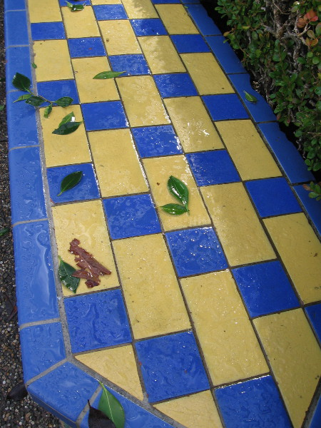 Leaves blown by a very windy storm on a wet tile bench in the Alcazar Garden.