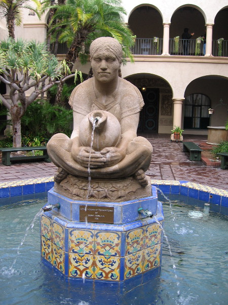 An iconic sculpture in the rain-wet courtyard of the House of Hospitality. Aztec Woman of Tehuantepec by Donal Hord, 1935.