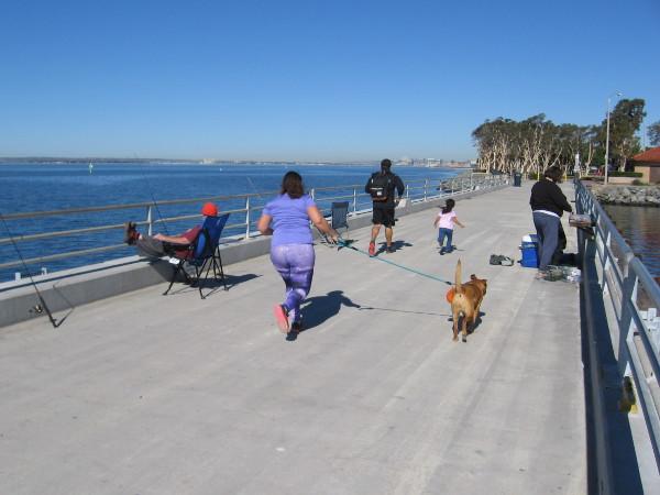 Walking the dog across Chula Vista Bayside Park's fishing pier, next to the marina.