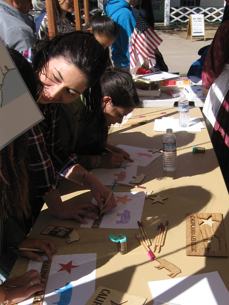 People draw the star and bear symbols of the California Republic.