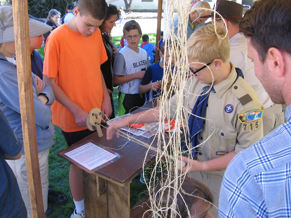 Scouts and other youth learn how rope was once made, using twisted fibers from native Yucca cacti.
