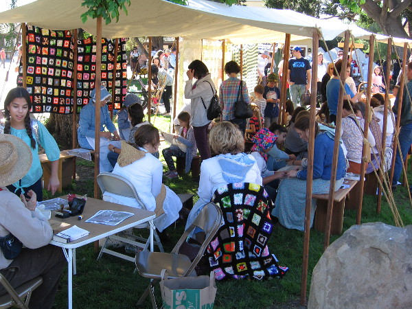 Lots of folks were in one tent learning about and making frontier dolls.