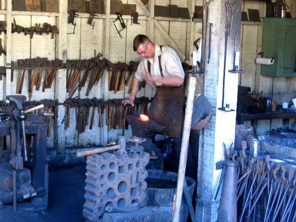 Shaping red hot iron in the old blacksmith shop.
