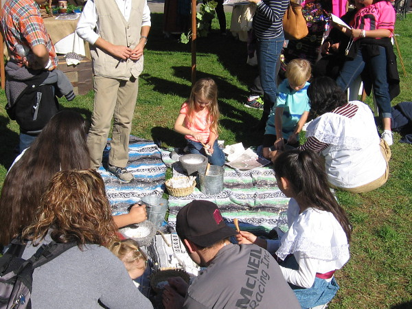 Kids were learning how acorns were mashed by the Kumeyaay and others in San Diego's early history.