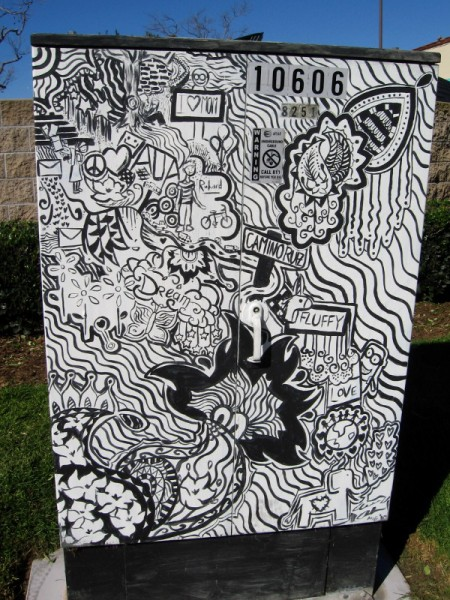 A happy dream takes the form of mazy images. This street art is on a utility box near the intersection of Mira Mesa Boulevard and Camino Ruiz.