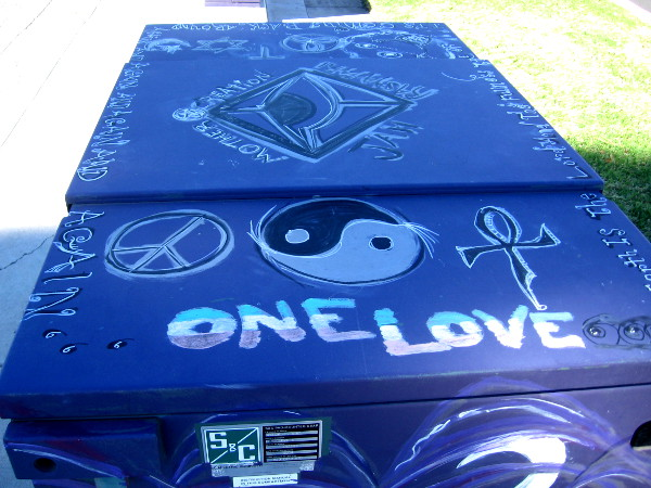 One Love and many symbols atop a utility box in Mira Mesa.