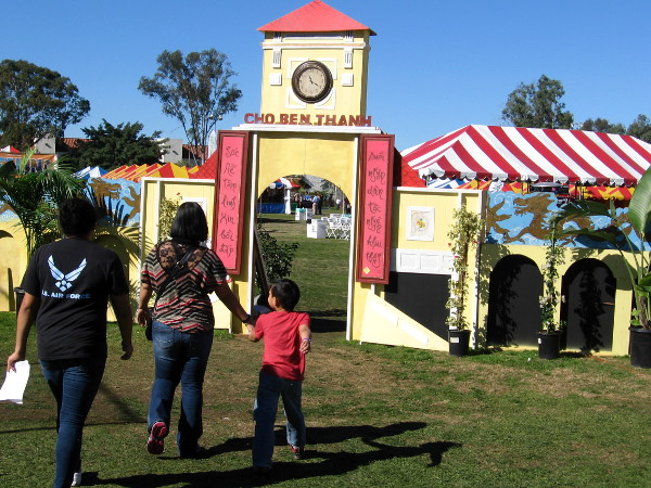 Visitors enter the San Diego Tet Festival as it opens late Sunday morning.