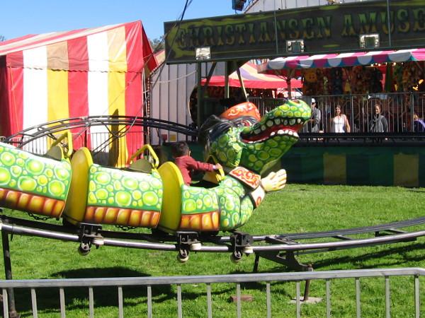 A child rides a dragon.