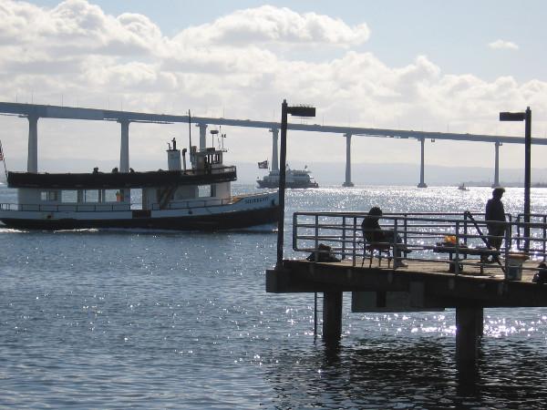 The Silvergate ferry heads toward Coronado beyond the Embarcadero Marina Park South fishing pier.