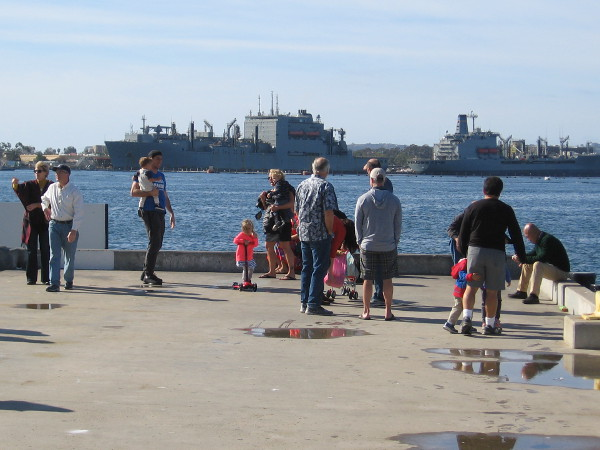 On New Year's Day lots of people are enjoying a walk by the water. I see two Navy oilers docked at North Island.