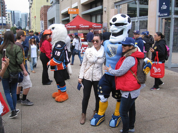 Fans of local sports teams pose with favorite mascots during the big Celebrate San Diego event at Petco Park!