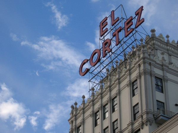 A crescent moon is just visible to the left of the historic El Cortez sign.