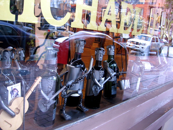Wine bottles converted into interesting human characters in the window of Michael J Wolf Fine Arts in the Gaslamp.