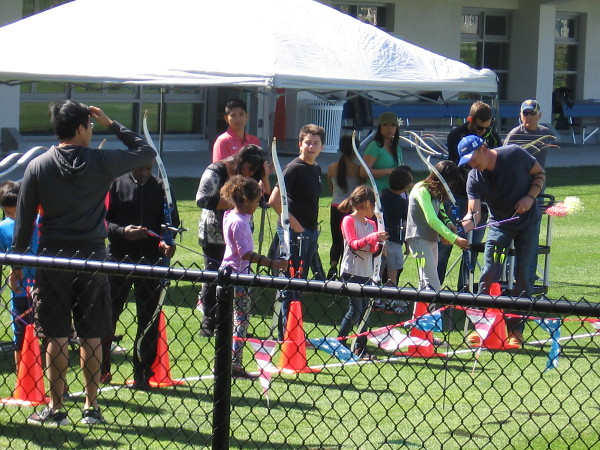 Kids see what Olympic-level archery is like during the Celebration of Champions event.
