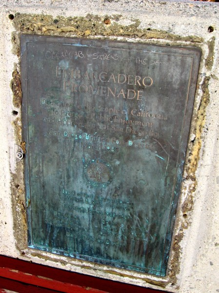 Corroded plaque on a planter by wood benches recalls the dedication of Embarcadero Promenade in 1985. Over thirty years later, the area is a bit ragged, but a fine place to sit and enjoy the scenery.