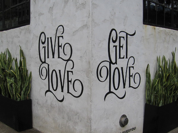 Wisdom on a corner of a downtown building. Give love. Get love.
