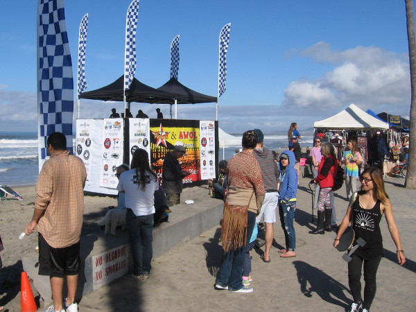 People gather near the beach to watch the 2nd Annual Ocean Beach Pier Surf Classic.