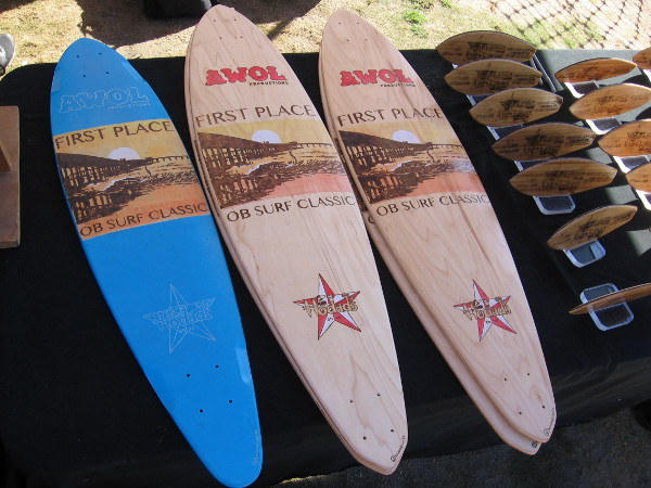 I believe the winners in different categories would take home one of these small surfboards.
