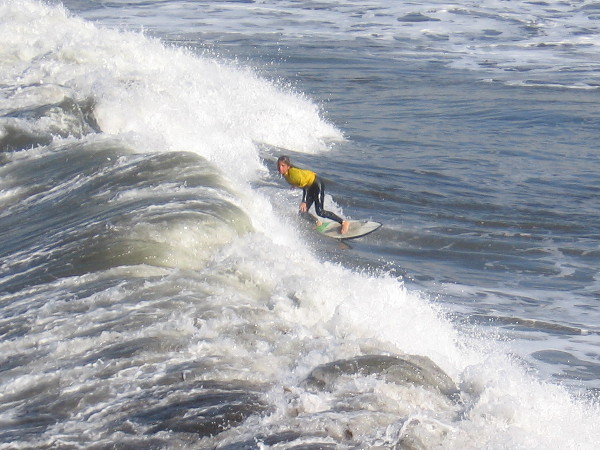 One of the surfers has caught a nice wave. The surf was very high today and made for some good rides.