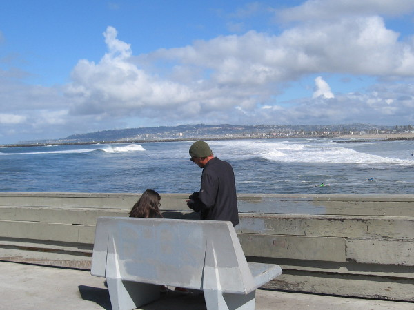 People enjoy a warm San Diego winter day on the OB pier.