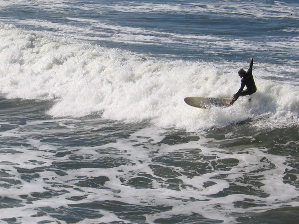 The guys surfing the south side of the pier were catching some fairly big waves.