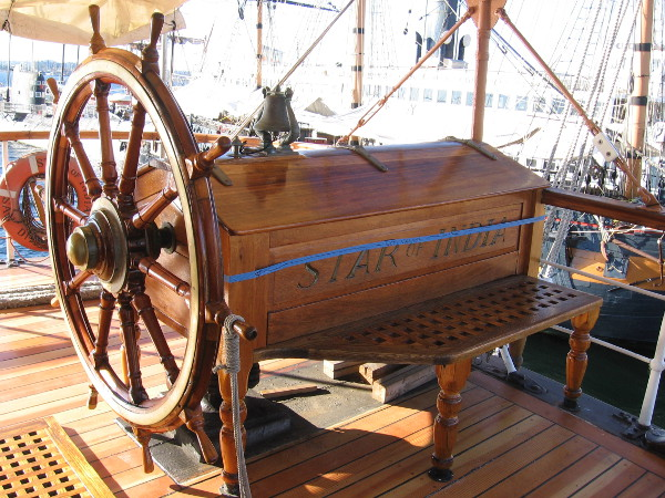 The helm's new varnish is still drying! In my dreams I command this amazing tall ship while standing at the wheel!