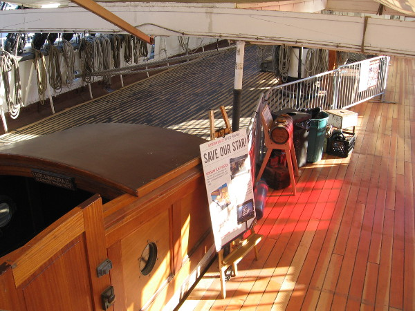 A contrast of the finished main deck on the starboard side. Soon the entire ship's deck will be shiny like new!