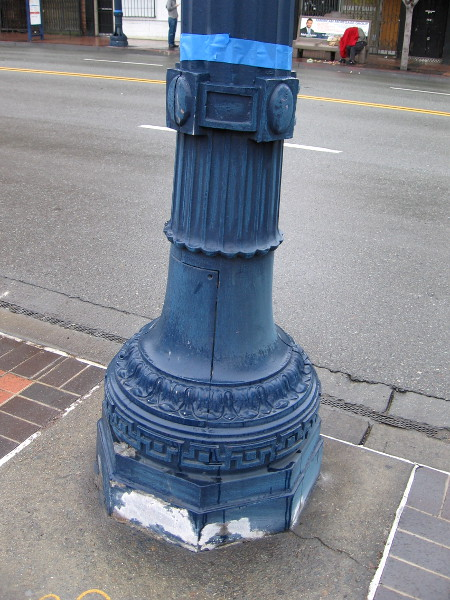 The base of a downtown lamp post has been primed and is ready to be painted by volunteers. Hundreds of posts would be painted today!
