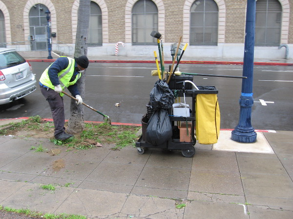 A worker for the Clean and Safe program beautifies downtown San Diego.