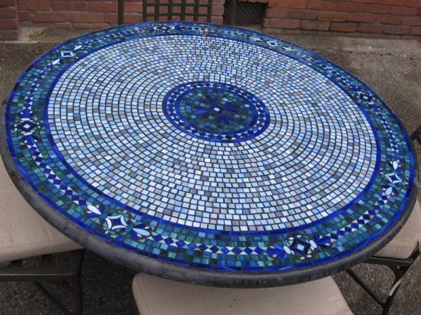 The mosaic tilework of an eatery's outdoor table in East Village.