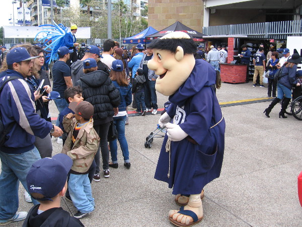 The San Diego Padres happy mascot, the Swinging Friar, greets visitors to the big local sports teams event.