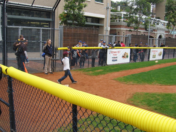 The small baseball diamond at Park at the Park was alive with excitement. This young fan smashed a line drive.