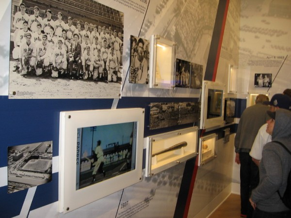 Padres fans check out lots of photos and cool artifacts which recall the history of baseball in San Diego. On the left are photos of the first Padres team in 1936, and Lane Field.