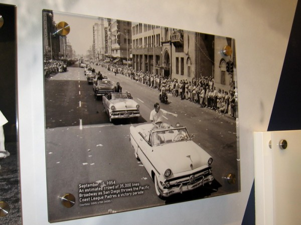 1954 photo of big celebration parade along Broadway in downtown San Diego. The Padres finished first in the Pacific Coast League.