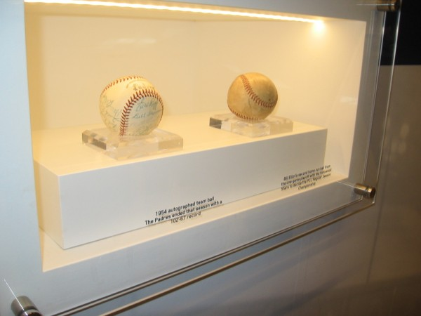 Autographed Padres team ball from 1954, and the home run ball smashed by Bill Elliot in the one game playoff to win the PCL championship.
