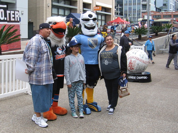Posing for photos with Gulliver, the San Diego Gulls hockey mascot, and Sunny the Socker, the new mascot of the San Diego Sockers!