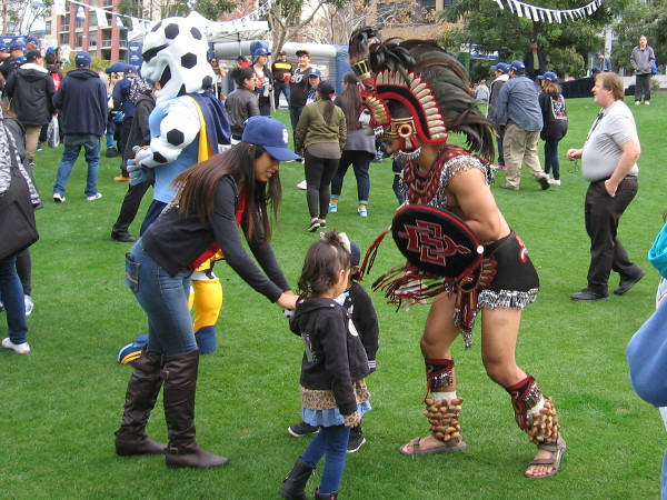 These kids seems a bit unimpressed by the Aztec Warrior, mascot of San Diego State University.