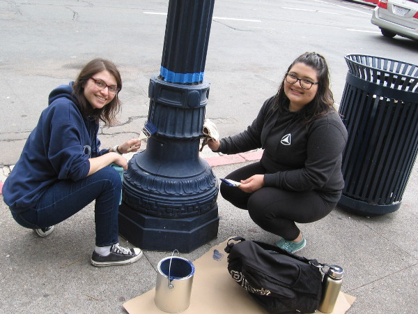 These nice volunteers were painting their third lamp post as I walked back through the area later in the day!