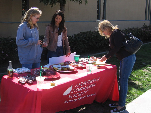 Generous young ladies have a bake sale in Point Loma to collect donations for the Leukemia and Lymphoma Society.