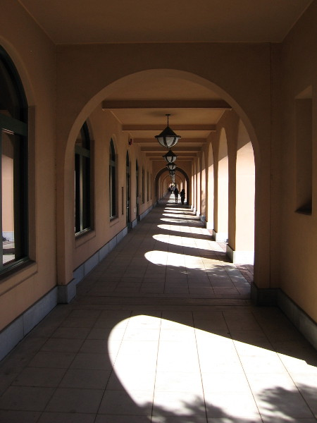 Looking down a long colonnade where U.S. Navy sailor recruits once walked.
