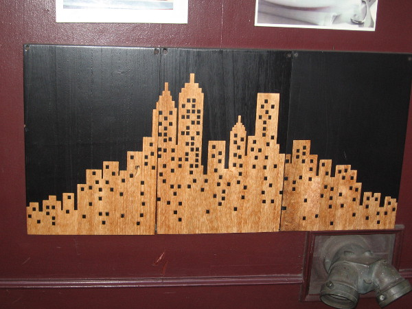 Depiction of a city on the wall of Sixth Avenue Bistro.