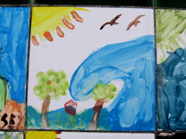 Birds above an ocean wave, painted on a ceramic tile by a young person. Many fun tile benches along the Embarcadero were created for a project titled Celebrating the Big Bay in 2004.