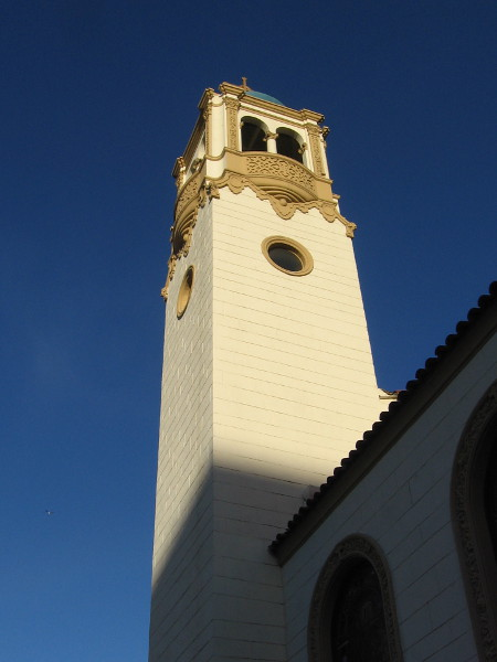 Sunlight on the high cathedral tower.