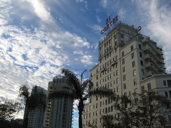 Amazing clouds paint the blue sky above the landmark El Cortez and other nearby, more modern high-rises!