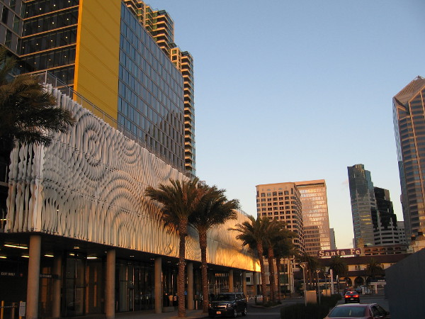 Golden light on the rippling sculptural facade of the Marriott building at Lane Field. The cool public art conceals hotel parking levels. It's titled California Rain and was created by artist David Franklin.